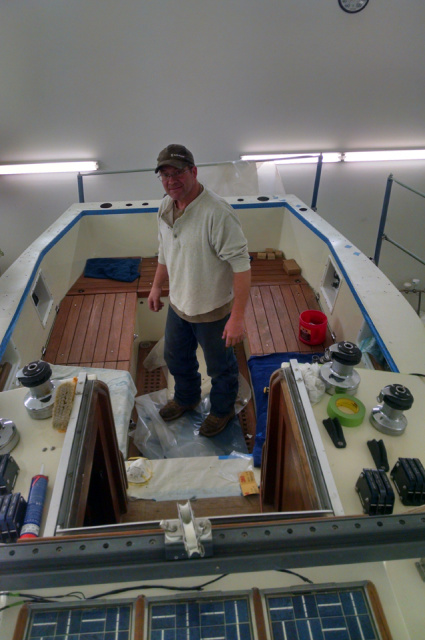 Taping off the area for the bedding of the teak decks aboard KaSondera