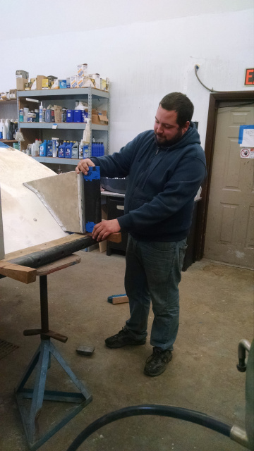 Winterport Boat Yard Manager Mike is inspecting the new custom made Push Knees